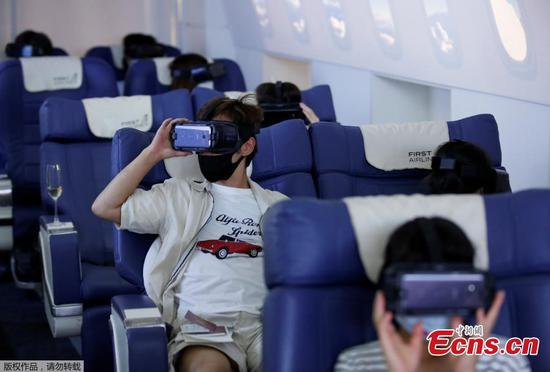 Boarding fake planes to take virtual vacations around the world